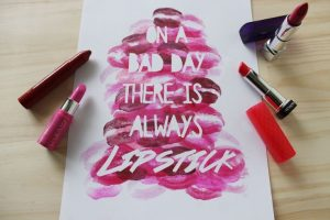 lipstick writing a message on a white paper